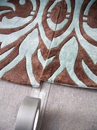 Large Living Room Rug How To Make One Large Custom Area Rug From Several Small Ones Hgtv