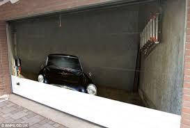 building an illusion the tarpaulin like base is attached to garage doors and can