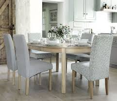 Extendable dining table with plates, cutlery and glasses.