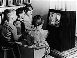 black kids watching tv. children watching andy pandy on a black and white tv kids tv r