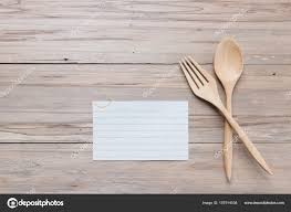 wooden spoon and blank memo on wood background stock photo