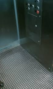 stainless steel studded rubber tiles in elevator