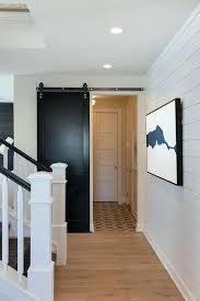 black sliding door black barn door on rails in mudroom black sliding door edge pull black