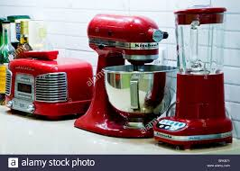 Retro Kitchen Appliance Red Retro Kitchen Appliances On A Worktop By Kitchenaid Stock