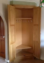 Fitted Oak Corner Storage Unit traditional-wardrobe