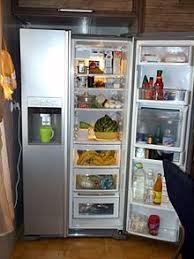 refrigerator and freezer. a side-by-side refrigerator-freezer with an icemaker refrigerator and freezer o