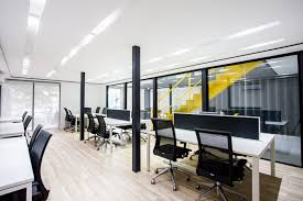 the interior is organized into several areas using glass walls that let the light travel through container office building v45 container