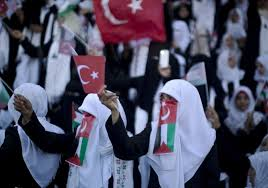 photo essay palestinian couples celebrate in mass wedding  palestinian brides wave palestinian and turkish flags during a mass wedding ceremony in gaza city