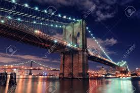 Brooklyn Bridge Lights Brooklyn Bridge Closeup Over East River At Night In New York