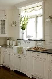 Lovely white modern farmhouse kitchen design with ivory kitchen cabinets  black granite counter tops, off-white subway tiles backsplash, farmhouse  sink, ...