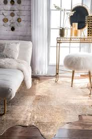 living room ideas with cowhide rug. bring the gorgeous modern look to you interiors with this beautiful hand-made, animal print, cowhide rug. available in creamy tans and shiny silvers, living room ideas rug o