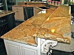 Quartz Versus Granite Kitchen Countertops Cambria Countertops Lowes Black Wooden Laminate Bar Stool Brick