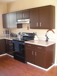 painting laminate kitchen cabinetsEasy and Affordable Kitchen Makeover  Update 80s laminate