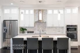 carrara marble backsplash white quartz countertops island quartz