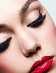 red lips basic eye makeup and a nice liquid eyeliner with some flirty lashes is