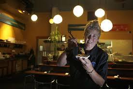 chef owner elsa corrigan offering her mama s basic shashimi hamachi cilantro serrano