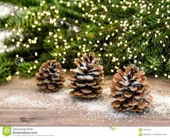 Pine Cone Christmas Decorations Pine Cone And Christmas Tree Branches With Lights Decoration Stock
