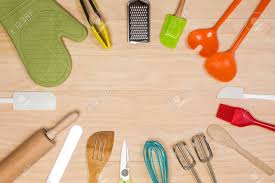 Colorful Kitchen Utensils On Wooden Background Stock Photo Picture