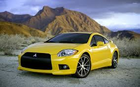 mitsubishi eclipse wallpaper. front view of a yellow mitsubishi eclipse wallpaper i
