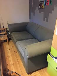 large sofa bed fortable and sy although cover now faded and worn