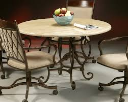Wood And Metal Round Dining Table Round Cream Wooden Dining Table On Carved Brown Metal Legs And