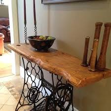 this table is made with a vintage singer sewing machine base and year old india old sewing