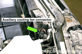 bmw e46 cooling fan replacement bmw 325i 2001 2005 bmw 325xi working in engine compartment disconnect the cooling fan electrical connector