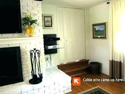 wall mounting tv above fireplace where to put cable box for wall mounted above fireplace above