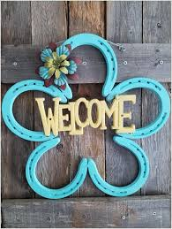 1 paint horseshoes and weld them together along with a cast iron welcome sign