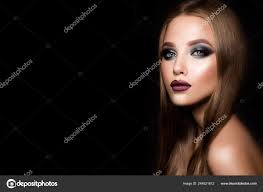 glamour portrait of beautiful model with makeup and romantic hairstyle fashion shiny highlighter on skin y gloss lips make up and dark eyebrows