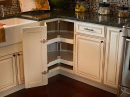 Kitchen Cabinet Corner Shelf A Corner Cabinet Door Opens To Reveal A Kidney Shaped Lazy Susan