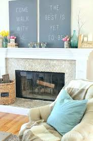 art over fireplace wall medium size of living above pictures decorated mantels nouveau insert art over fireplace