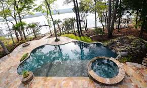 overhead view free form pool spa combo with rock waterfall with water view