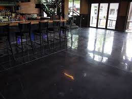 A polished concrete floor with a black stain and white decorative joints  provides a beautiful,