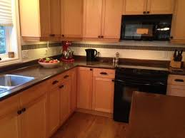 maple kitchen before cabinets were painted and new countertop and backsplash