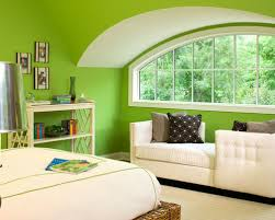 living room green walls. example of a classic bedroom design in minneapolis with green walls living room
