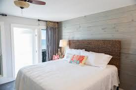 cape cod bedroom ideas with wood wall paneling and seagrass headboard also bedding ideas for master