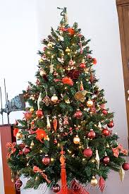 Christmas tree with ornaments in red and gold