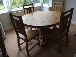 chunky rustic solid mexican pine round dining table and 4 matching chairs excellent