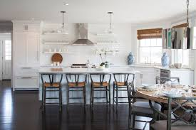 globe pendants over island. Wonderful Pendants Gorgeous Kitchen With Clear Glass Globe Pendants Illuminate White Marble  Topped Island Lined Grey Wishbone Barstools Situated Across From Stacked  Inside Globe Pendants Over Island