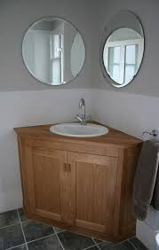 small bathroom sink vanity. Image Of Aesthetic Corner Sink Bathroom Vanity Cabinets From Oak Wood Material With Oval Undermount Basin Small