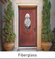 exterior double doors. Brown Door With Oval Window And Tall Green Bushes On Either Side Of The Entrance Exterior Double Doors E