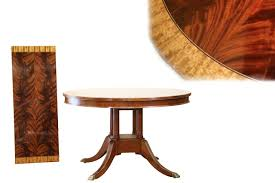 high end 48 inch round mahogany dining table and leaf seats 2 to 4 people