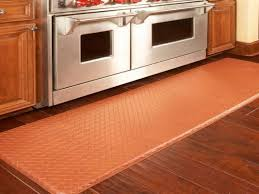 rubber kitchen rug in red color dark brown stained wood planks