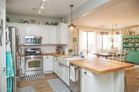 white country kitchen with butcher block. Interesting Country Country Kitchen With Chandelier Wood Counters Ikea Hammarp Butcher Block  Countertop Birch Flat Panel Cabinets Flush Light In White With