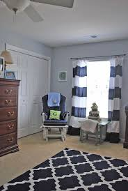 gray walls white curtains with navy stripes sewed on blue rug exotic rugs for nursery lovable