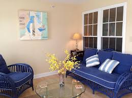 sunroom furniture set. Fine Sunroom Impressive Small Sunroom Design With Blue Chair And Cream Wall  Color Also Round Shape Glass Coffee Table Idea Throughout Furniture Set