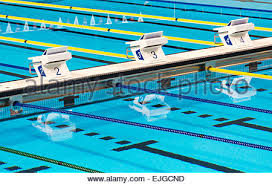 olympic swimming pool lanes. Beautiful Olympic Sport Competition Swimming Pool Lanes In A Clear Transparent Blue Water Facility - Stock