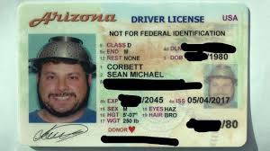 Wears Strainer Man In com Head His Fox5sandiego Photo License On Driver's
