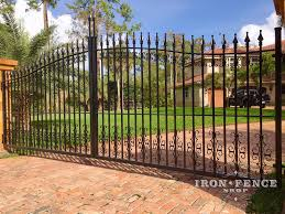 wrought iron fence gate. Wrought Iron Driveway Gate With Guardian And Butterfly Decorations Fence